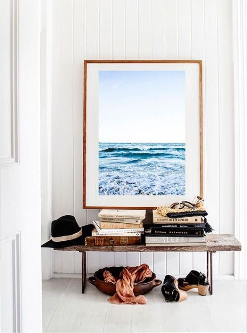 Nothing says welcome home quite like this stylish seaside photo and bench to shed your handbags and shoes.