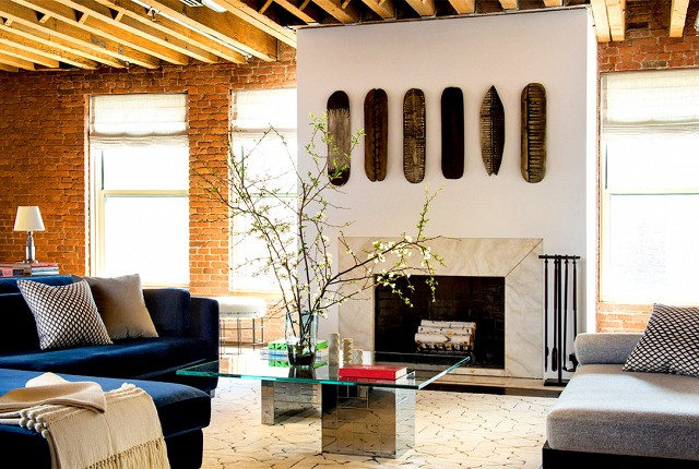 These wooden antique skateboards hanging above the fireplace give this apartment a taste of the streets of New York.