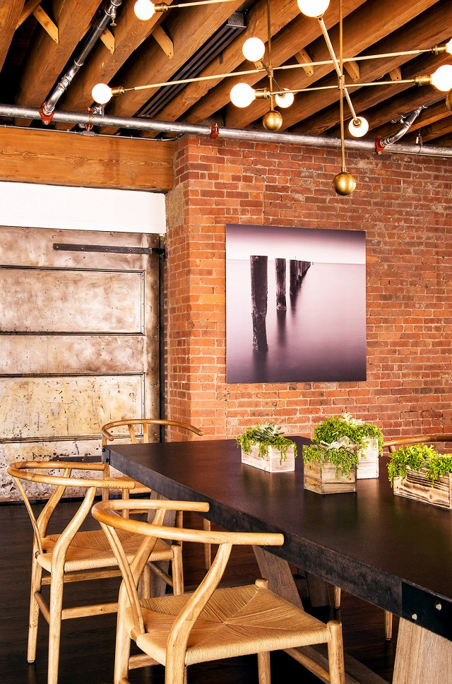 I'm obsessed with Carl Hansen and Son Wegner's wishbone chairs.  They look amazing in any space, but are especially befitting of this gorgeous dining room with exposed brick walls.