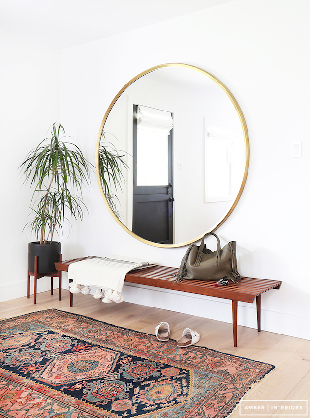 Every boho inspired home should have a Persian rug in the foyer. Add a plant and round mirror to hone this look even more.
