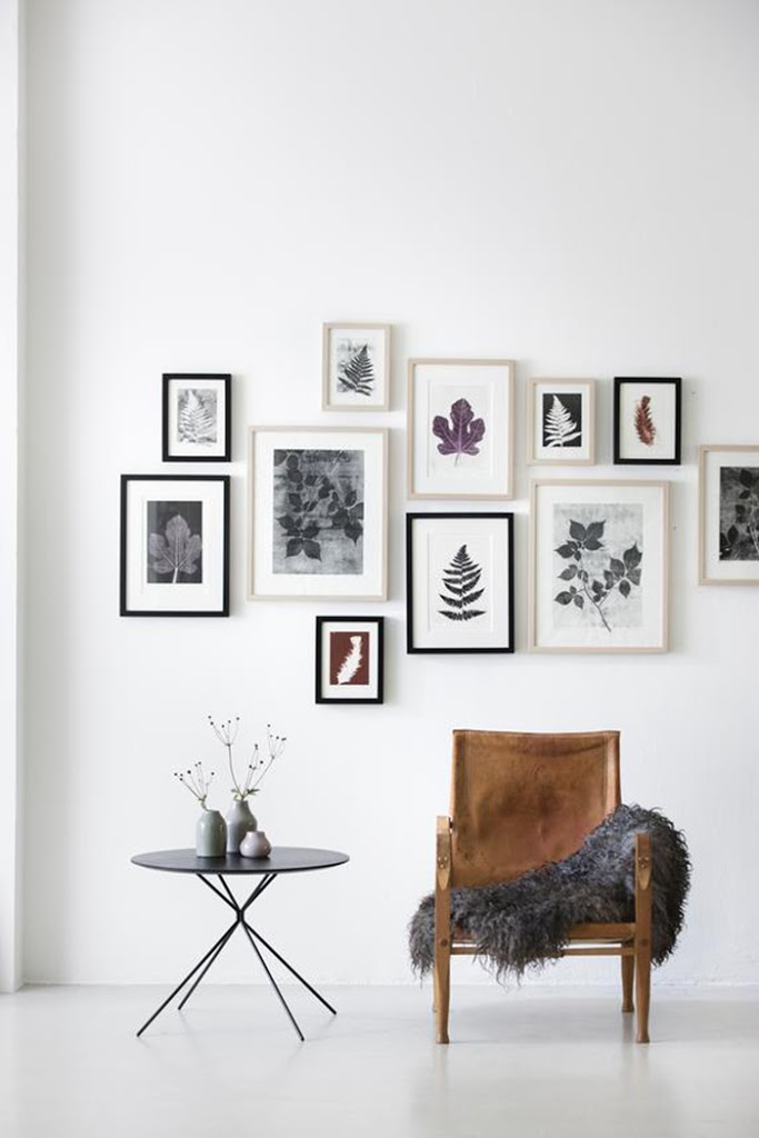 For untraditional entryways that open up to the rest of the room, consider maximizing the white space to create a minimalist vibe. A gorgeous chair and several small frames can go s long way. The small side table is perfect for placing keys and books.