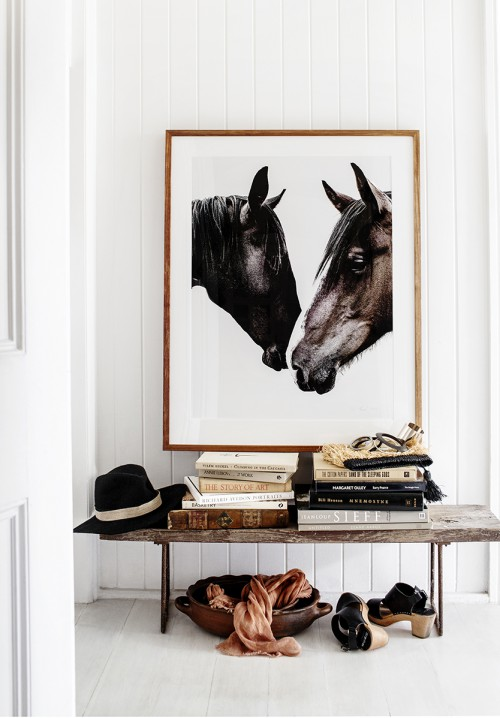 For animal lovers, consider an elegant photo with thin frames and matting.  This rustic bench with rusted legs is an easy DIY project for your entryway.