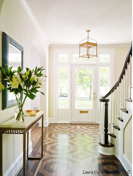 I love how this foyer keeps it simple and lets the overhead lighting become the focal point.  Such a great way to make your entryway stylish without spending a lot.