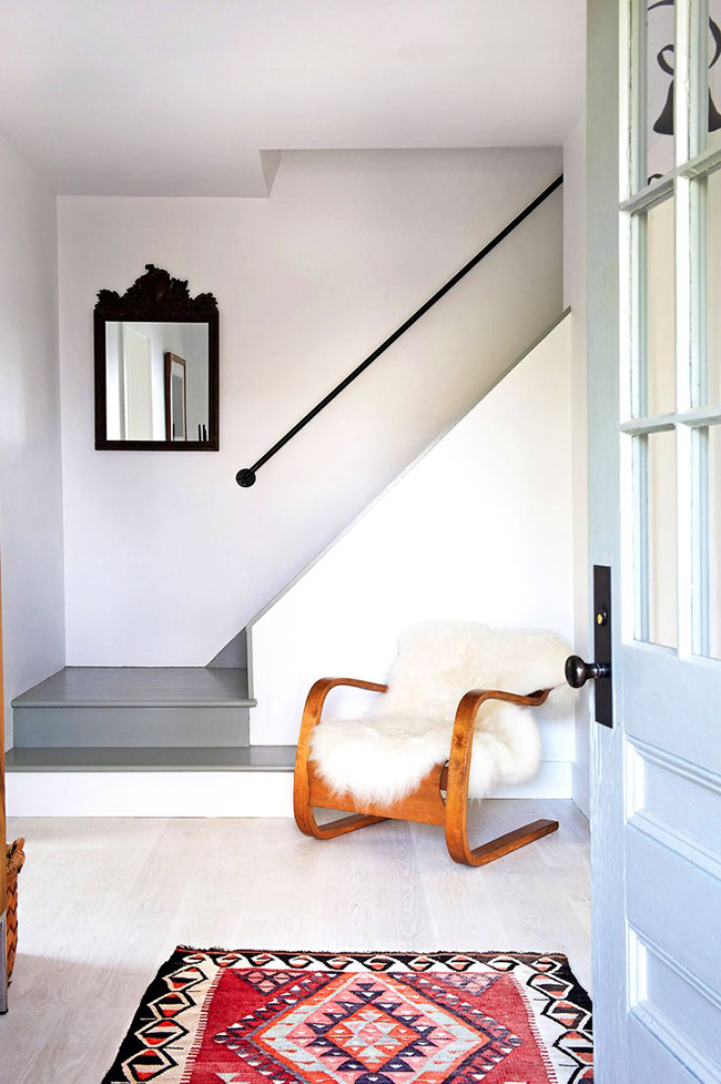 For that awkward entryway space, consider a simple rug and chair to show off your stye.