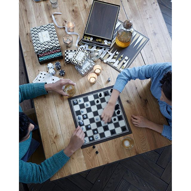 Chess and checkers are the perfect games for two players on Thanksgiving.  Add a glass of wine or cocktail and game night has begun.