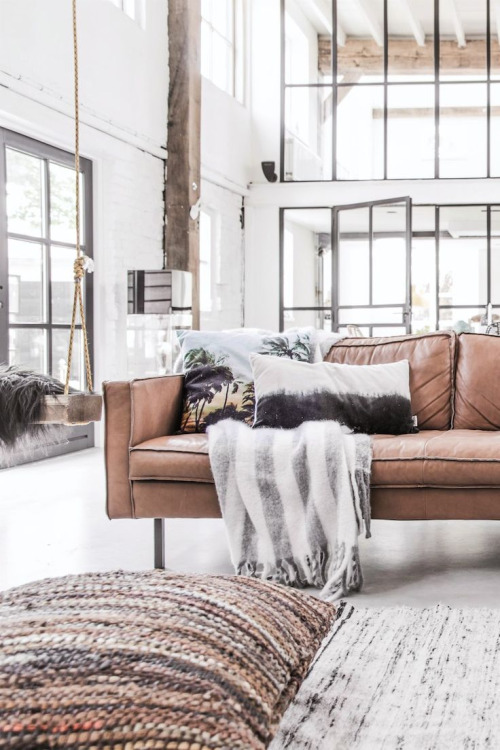 I just can't even!This loft nails the organic modern look -- from the marbled rug and floor pillow to the soft leather couch and steel-framed windows / doors. It's too good not to share!
