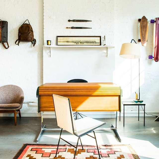 This antique midcentury desk is everything!  I wish my office looked as cool as this NY space.