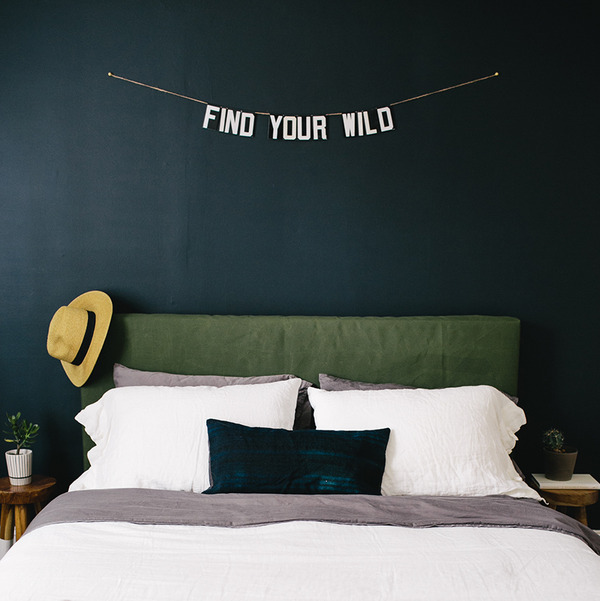 After painting your room a dramatic dark blue, you'll still have enough left over to make and hang your own mantra above your bed.