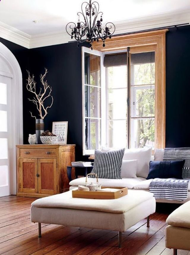 I love how the warm wood balances the cool navy blue wall color in this living room.