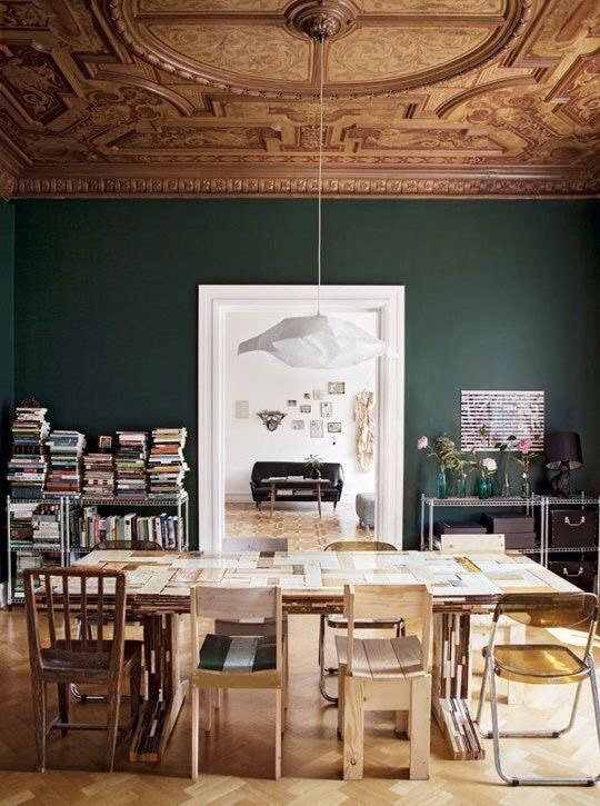 The juxtaposition of this informal dining room and the formal hunter green wall color is so refreshing.  One of my favorite dining rooms by far!
