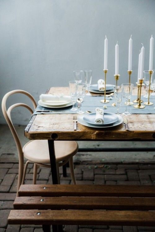 This shade of light blue is rustic and romantic is especially when paired with a matching table runner and plates.  The gold candlesticks is the perfect compliment to it.