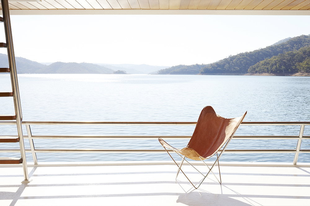 This chestnut leather chair provides the perfect view point to see the world from the deck.