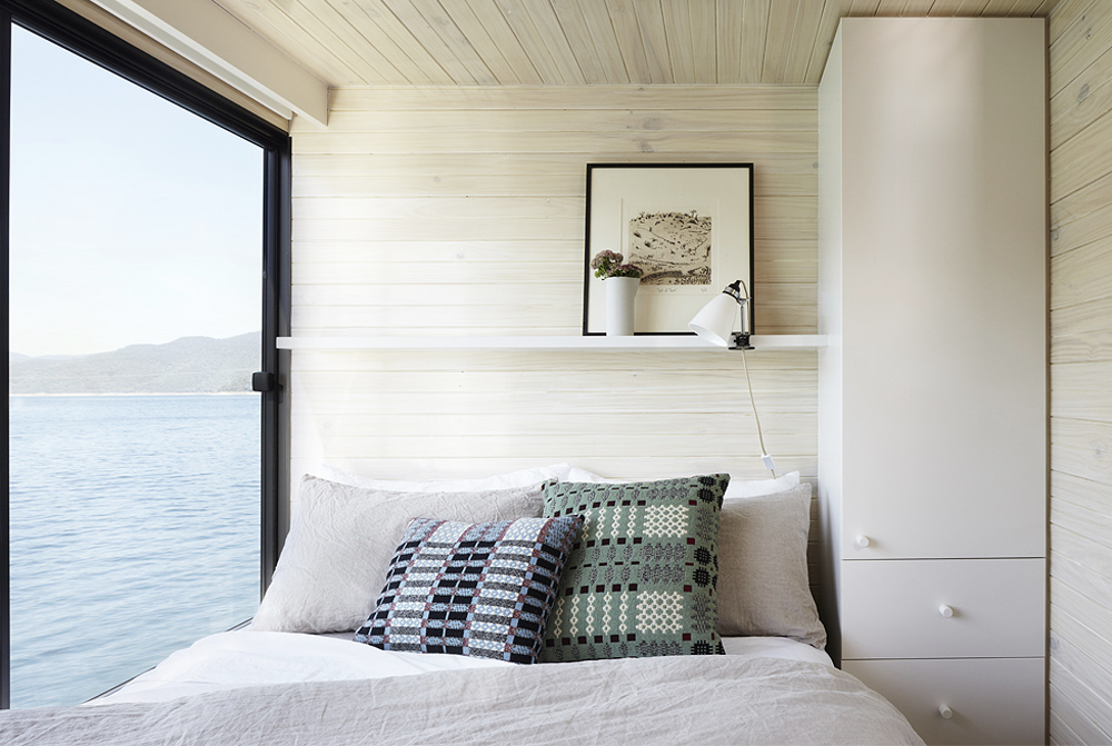 While the bedroom quarters are tight on this ship, I do love the linen duvet and chunky knit pillows.  Plus with a view like that, I don't think anyone would mind the space.