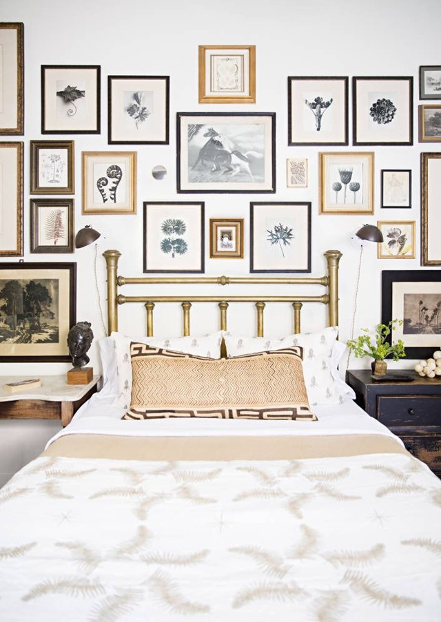 Try botanical prints for a gallery wall like this chic bedroom.