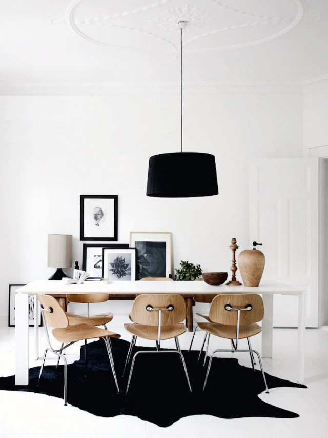 Keep it interesting with a simple color palate like this black and white gallery wall in the dining room.