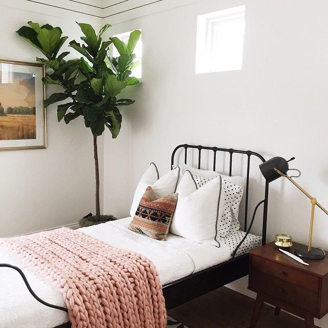 This room nails it when it comes to designing and decorating a small bedroom.  From the bed frame to the chunky knit blanket and more, it's perfect!