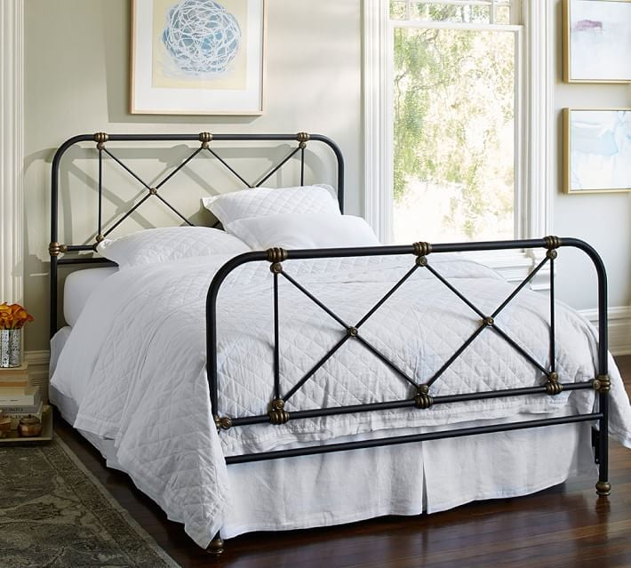 Metal bedframes add dimension and height to a small bedroom.  I love this frame!