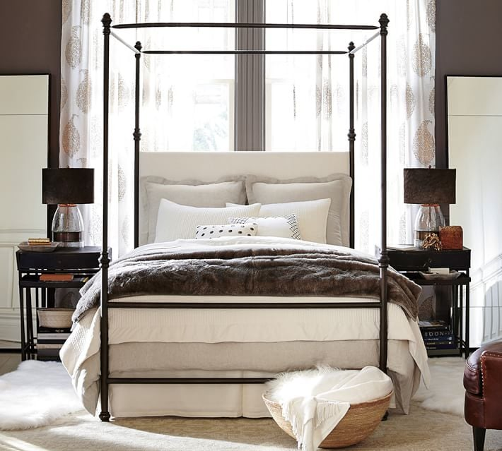 Canopy beds are the best when it comes to decorating a small bedroom since it adds lots of height and dimension.  This frame from Pottery Barn is my fave!