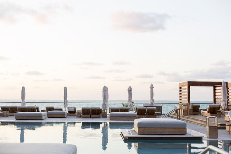 Like any pool scene in Miami, 1 Hotel South Beach's pool is crazy hot, especially with a beachfront ocean view!  The pool deck decor's white linen padded chaise lounges are tres chic!