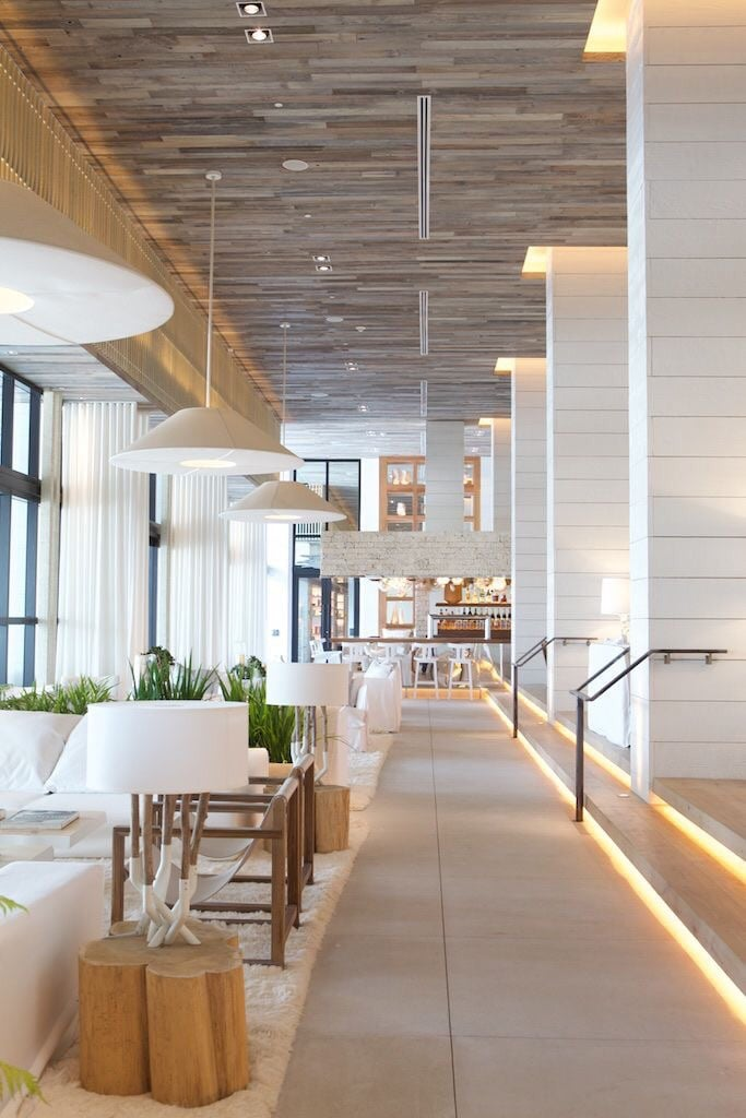 White linen couches atop matching white shag rungs are plentiful in the lobby of 1 Hotel South Beach.