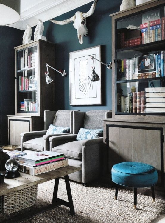 Dark wall colors highlight the original details in a pre-war apartment while also giving it a modern design update.