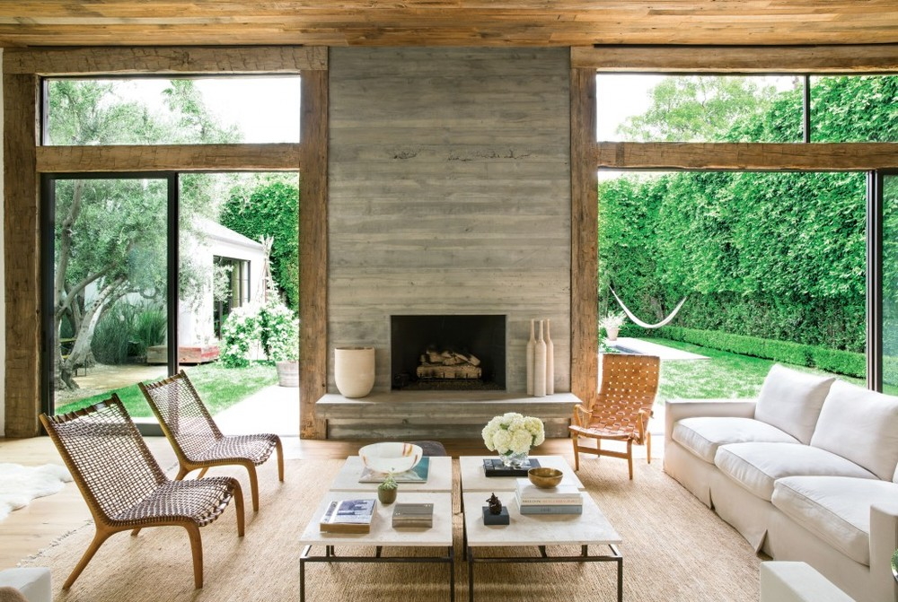 This Beverly Hills living room uses neutral tones in the jute rug and woven chairs to highlight the softer ivory-toned sofa and four-piece coffee table.