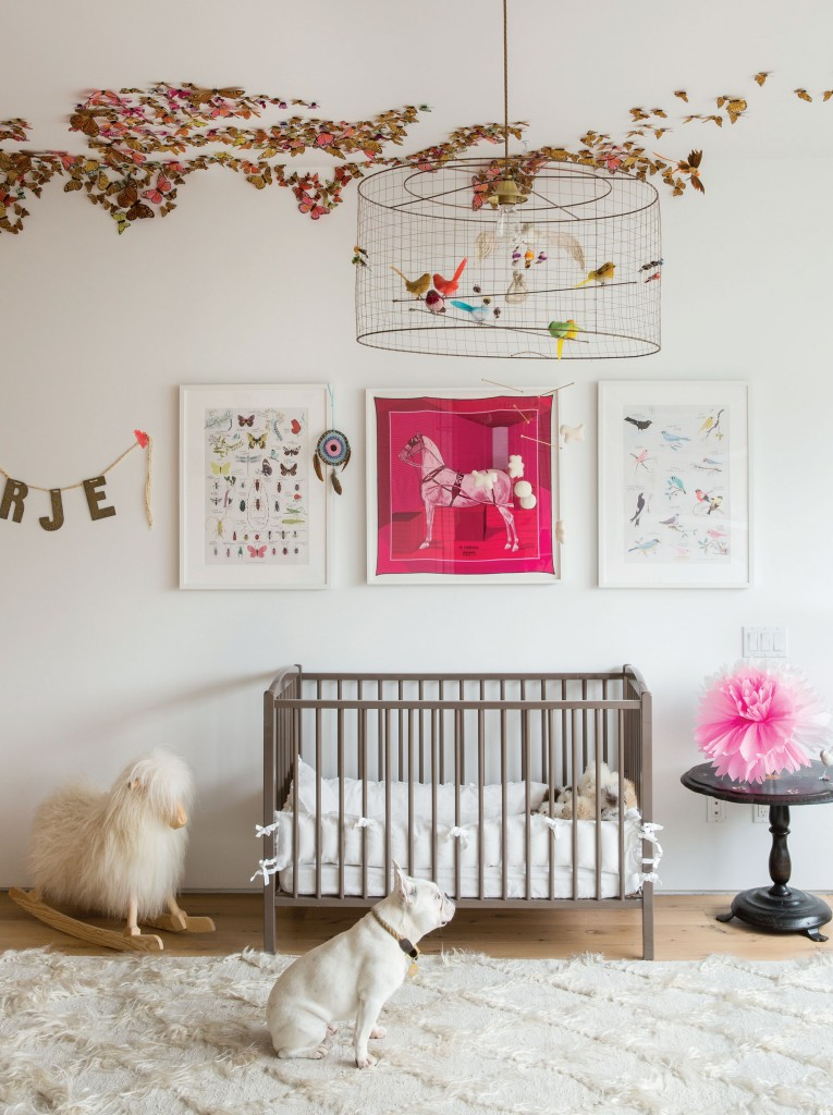 The nursery is a sanctuary complete with butterflies on the ceiling, a fuzzy ivory rug, and aviary lamp.