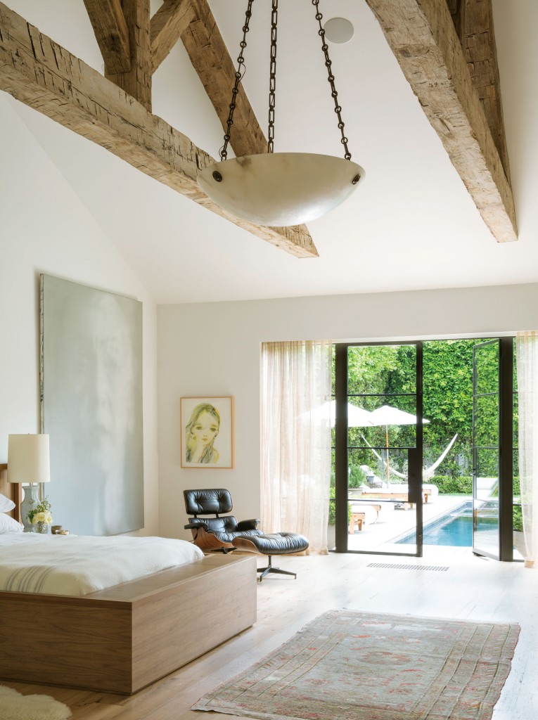 The master bedroom suite combines a simplistic organic modern style with eclectic art pieces.  It also doesn't hurt that this first floor bedroom looks out to the gorgeous pool and hammock.