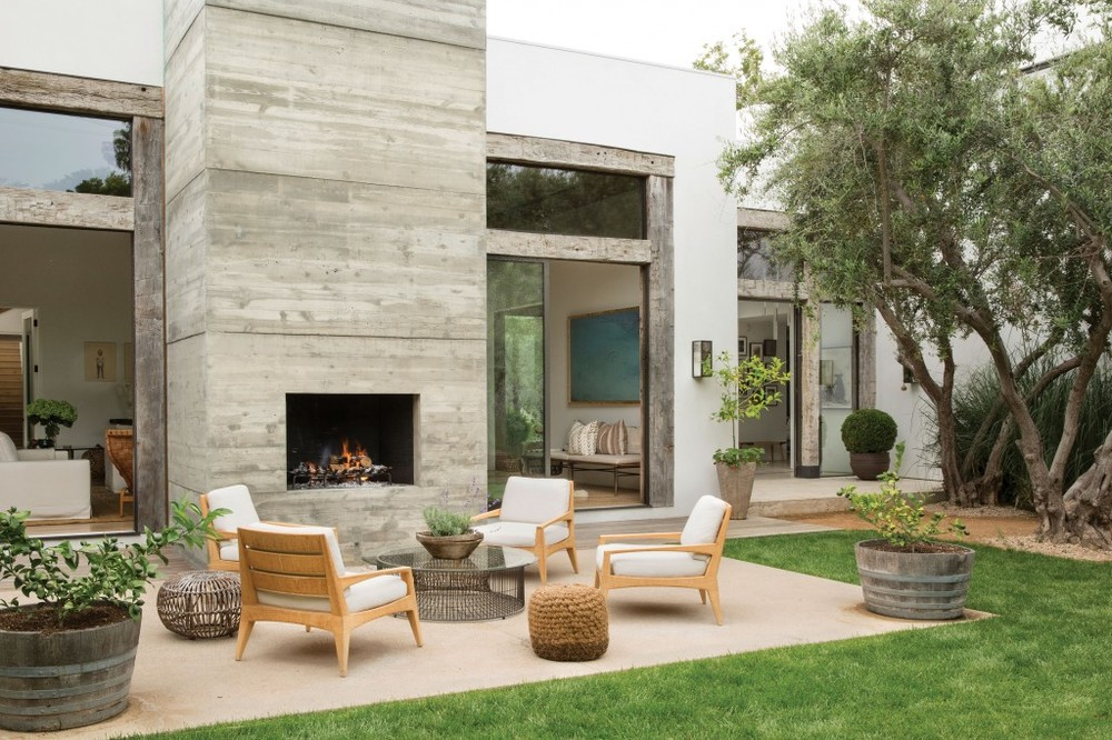 It's hard not to fawn over this outdoor patio with a custom fireplace and gorgeous outdoor furniture.