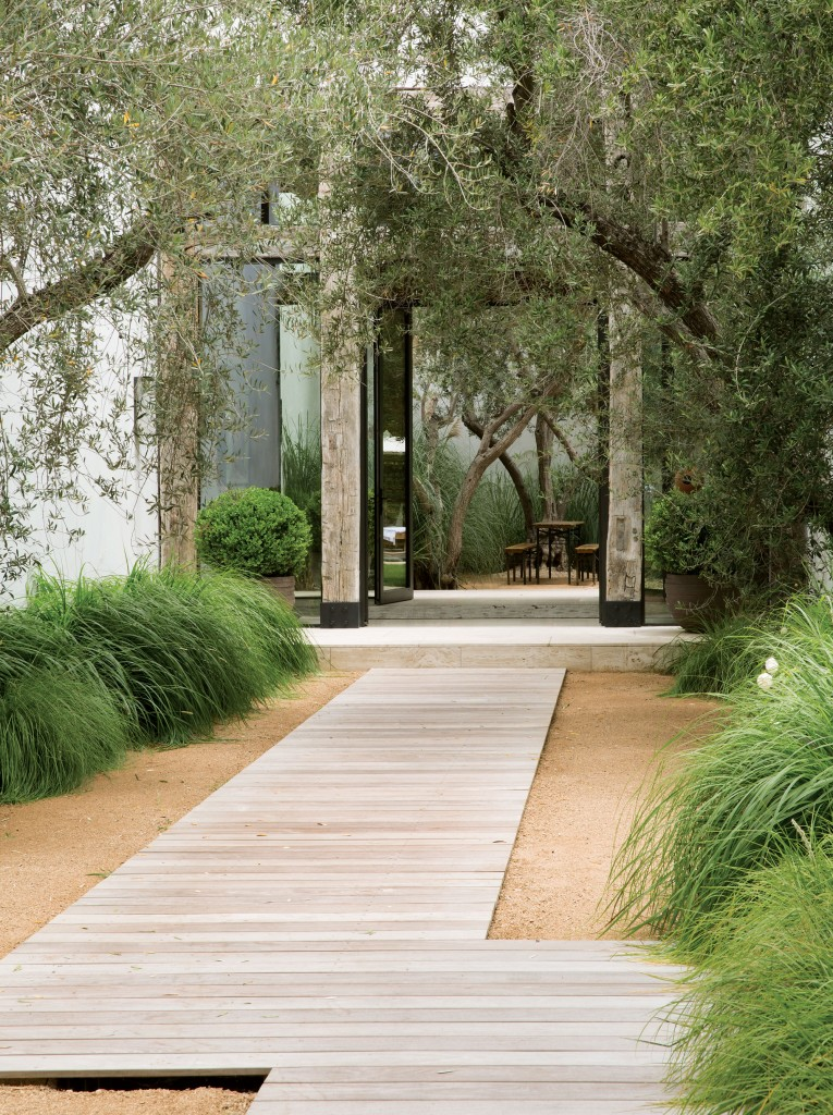 The wood-planked walkway is reminiscent of the beach walkways one might find in the Hamptons or Cape Cod, without any of the headaches of modern travel.