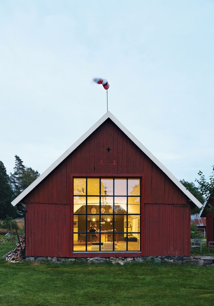 The large windows in this red Swedish barn make all of the difference!
