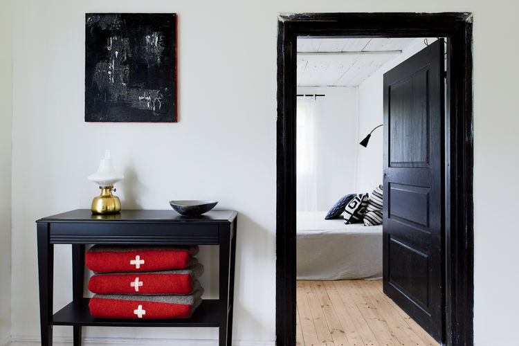Black furniture pieces are not only functional for their storage space, they also fit well into the aesthetic matching the black door and door trim.