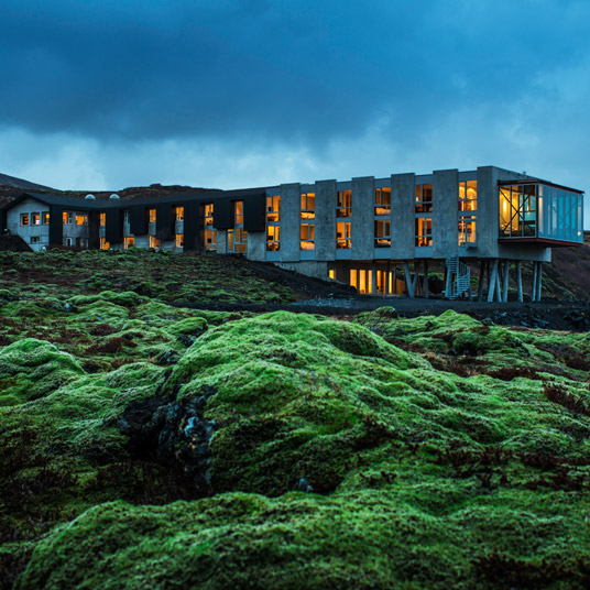 In Spring and Summer, the mossy emerald grass is a wonderful contrast to the amber lights of the hotel.
