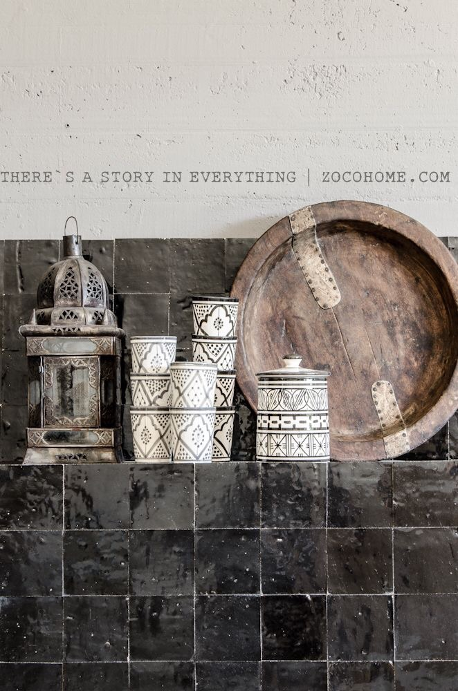 For a polished look, try black kitchen backsplash with black and white Moroccan dishware, and muted neutral accents.