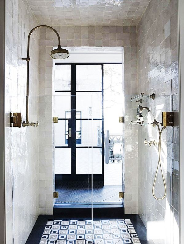 I love the blend of bright Moroccan tiles on the floor of this shower and the white square tiles on the shower wall.