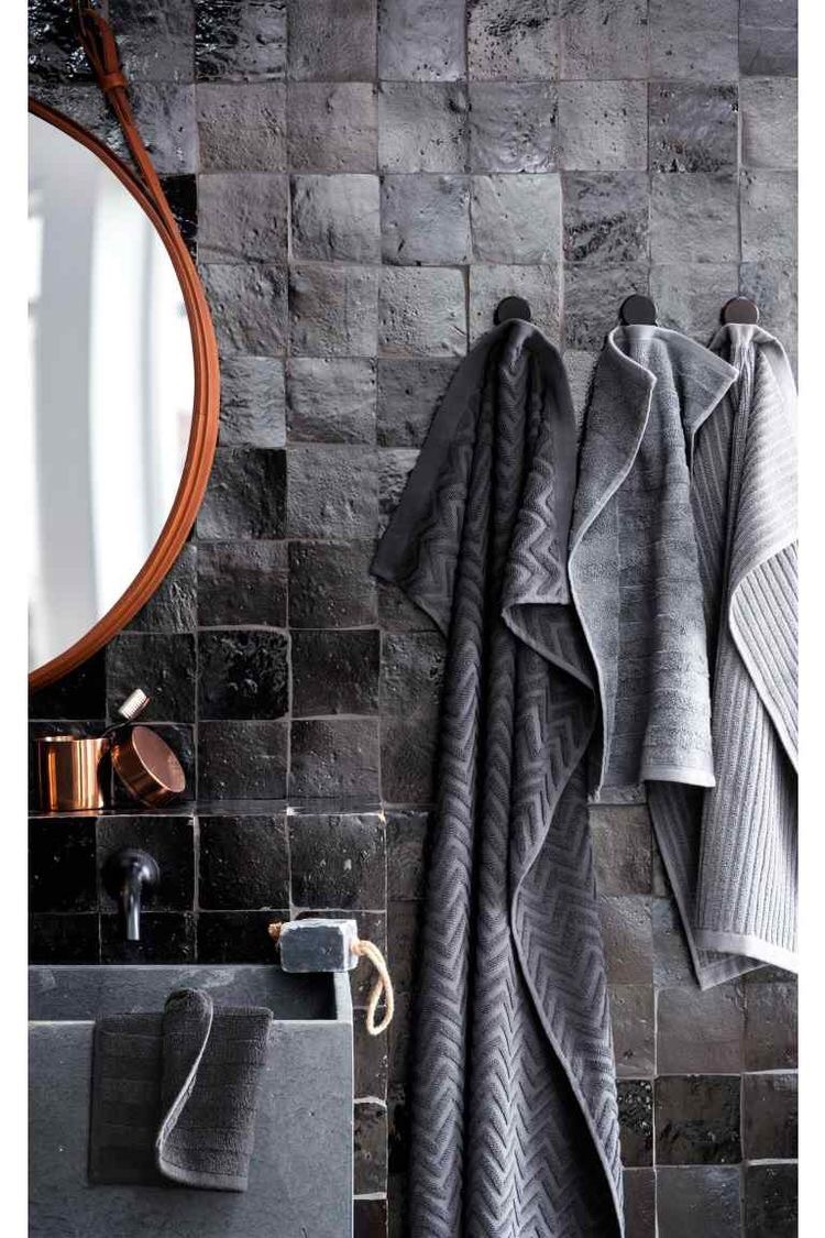 This all black bathroom with Moroccan Zellige tiles feels sophisticated, modern, and edgy.