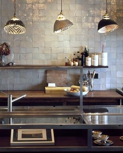 Nailed it!  This industrial kitchen keeps it simple with square Zellige tiles in a pearly white.
