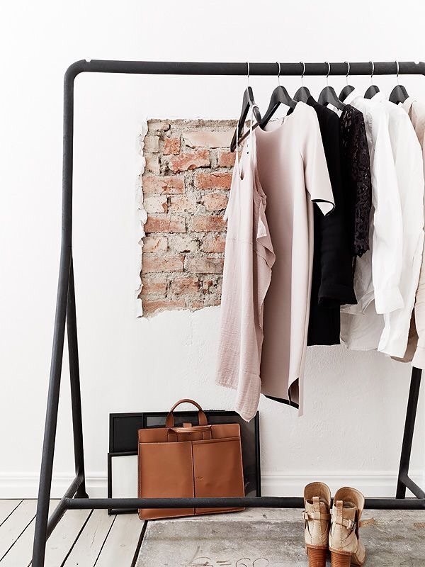 open closet rack brick wall