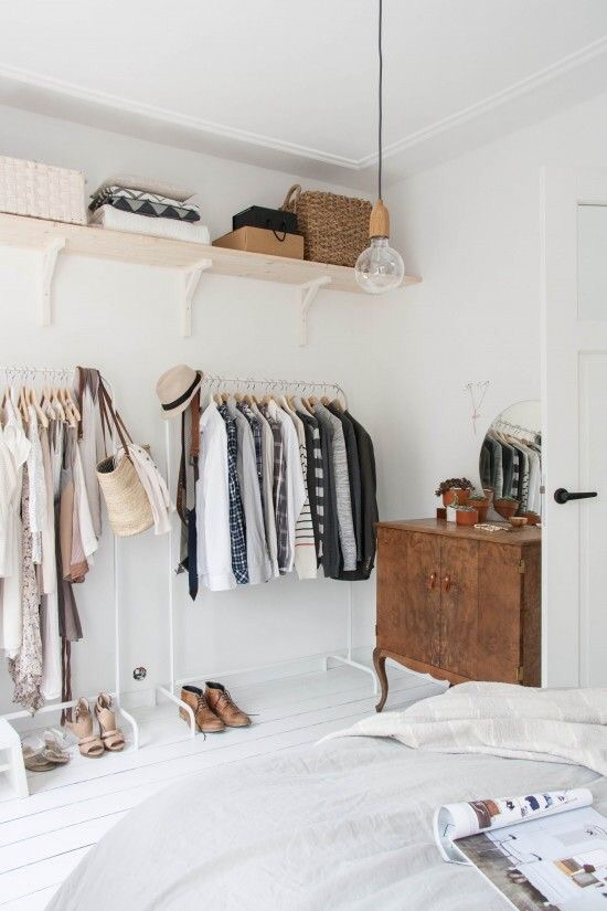 It's important to pair similar clothes next to each other for a cohesive look when using open shelves.