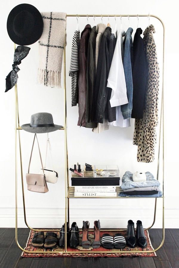 Add an S-hook to hang cross-body handbags on an open closet rack.  Add a small persian rug on the bottom to keep shoes in top shape.