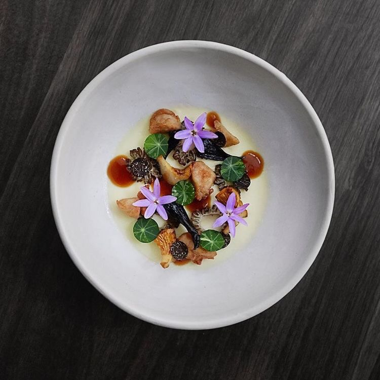 Edible flowers add a pop of color to the appetizer.