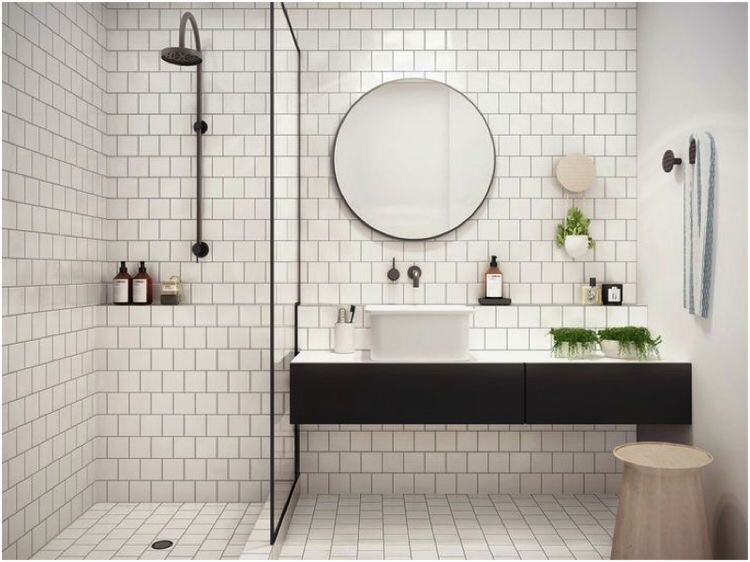 The potted plants in this subway tiled bathroom give it a pop of color and sophistication.