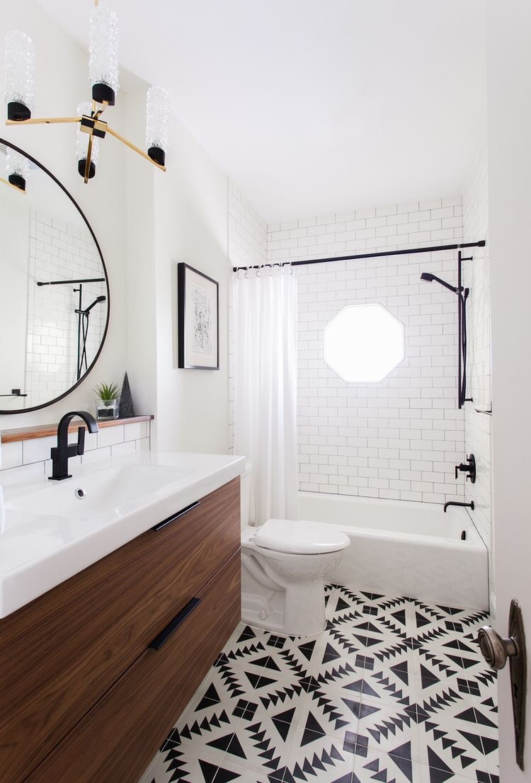 The black and white tile in this bathroom is hip and chic.