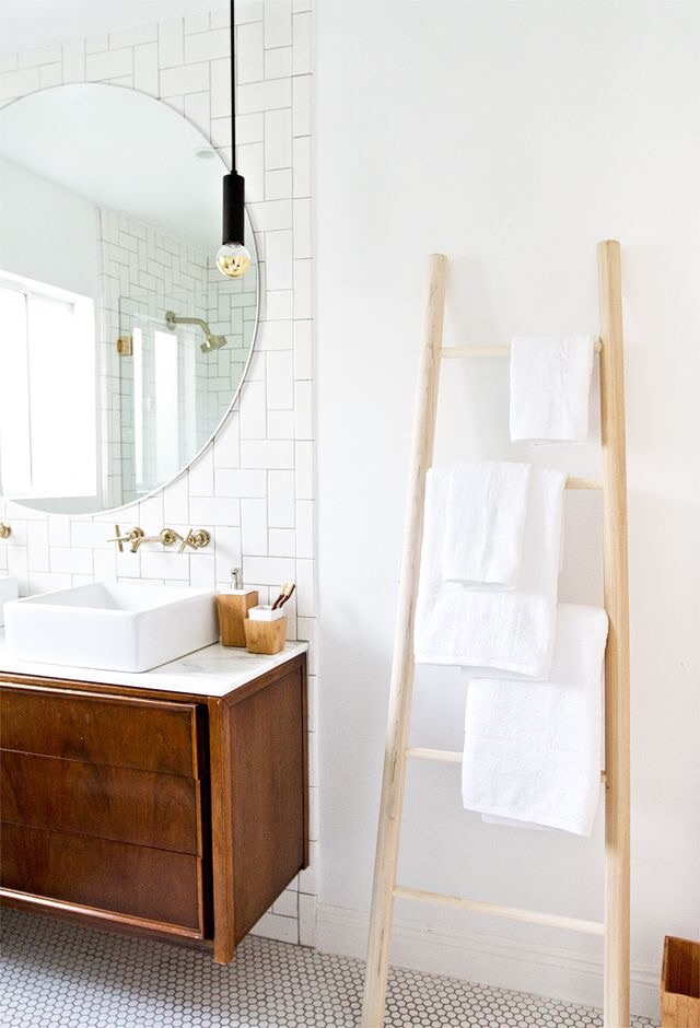 Adding a spa tower or towel rack lends storage and style to your bathroom.
