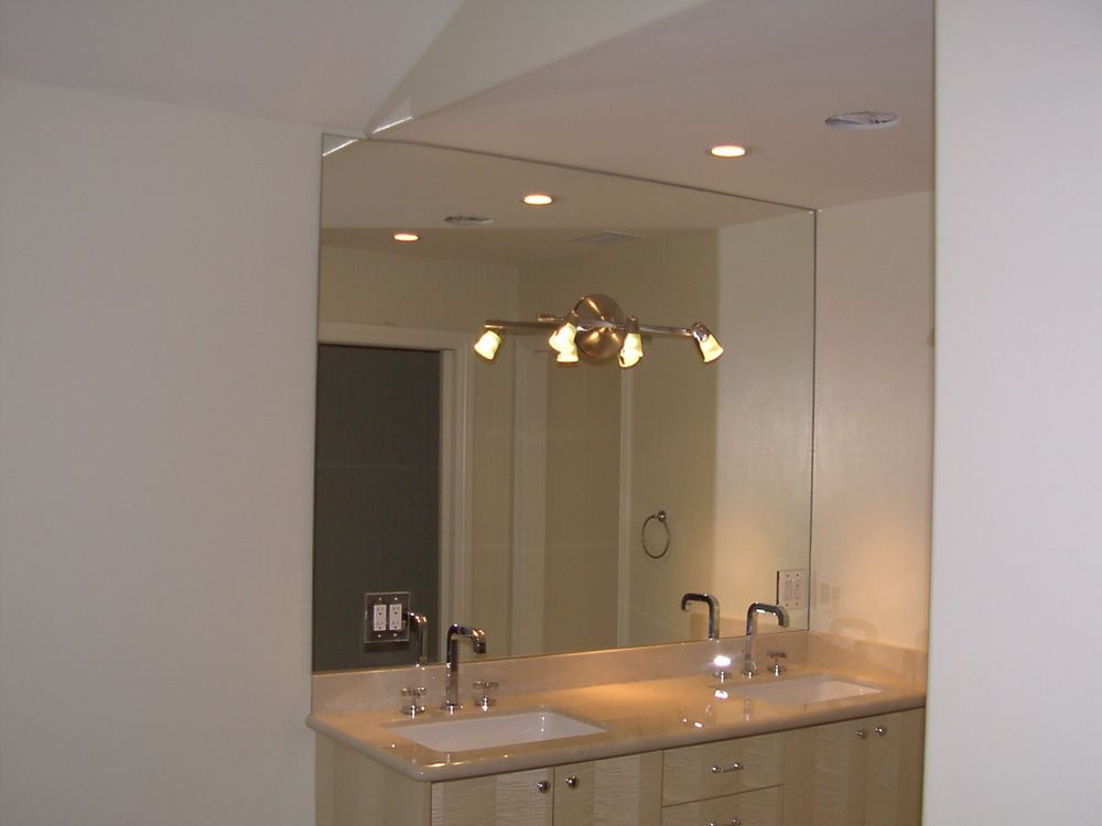 Nothing says boring faster than the sight of a mirror spanning the entire side of a vanity or wall.