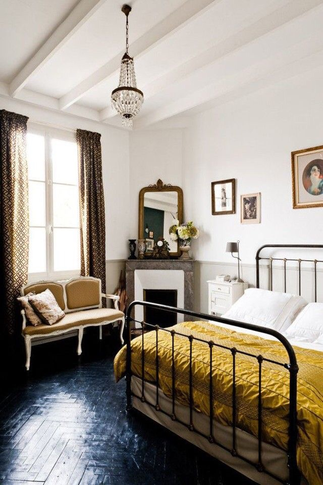 The eclectic art and mirrors in this bedroom shine bright.  Love how the frames match the marigold duvet.