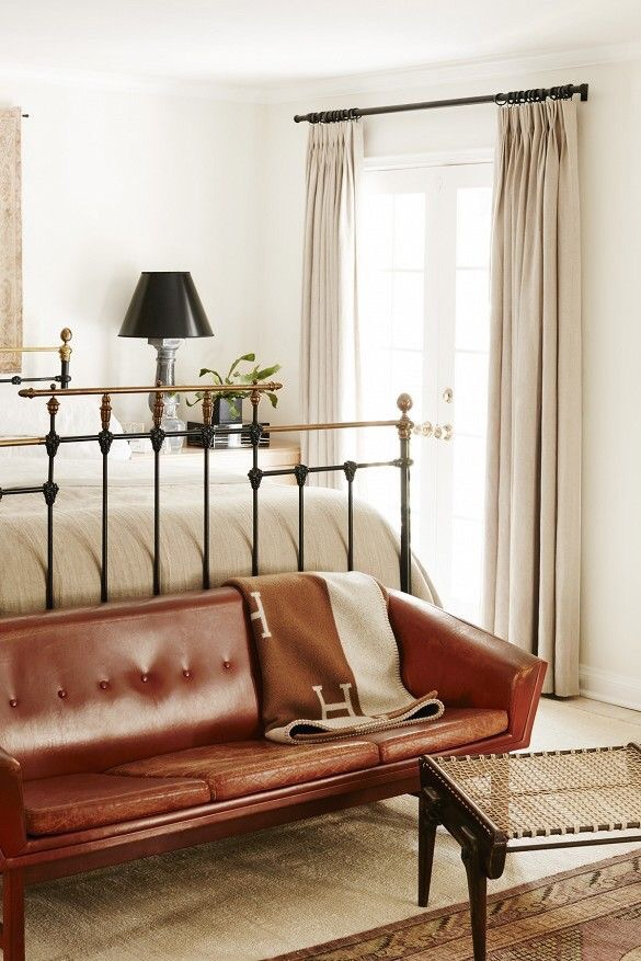An Hermes throw blanket makes any room look better.  Well that and a cozy leather bench at the end of the bed.