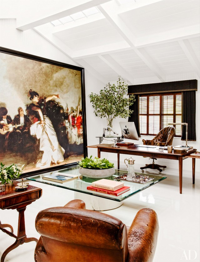 This sophisticated gentleman's office brings harmony to its traditional rustic decor by adding green plants and oversized reproduction of a John Singer Sargent painting.