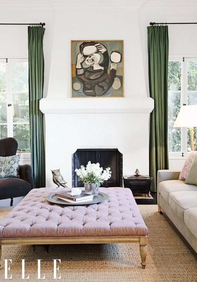 Gennifer Goodwin's living room is perfectly accented with olive green curtains and beautiful French country tufted coffee table.