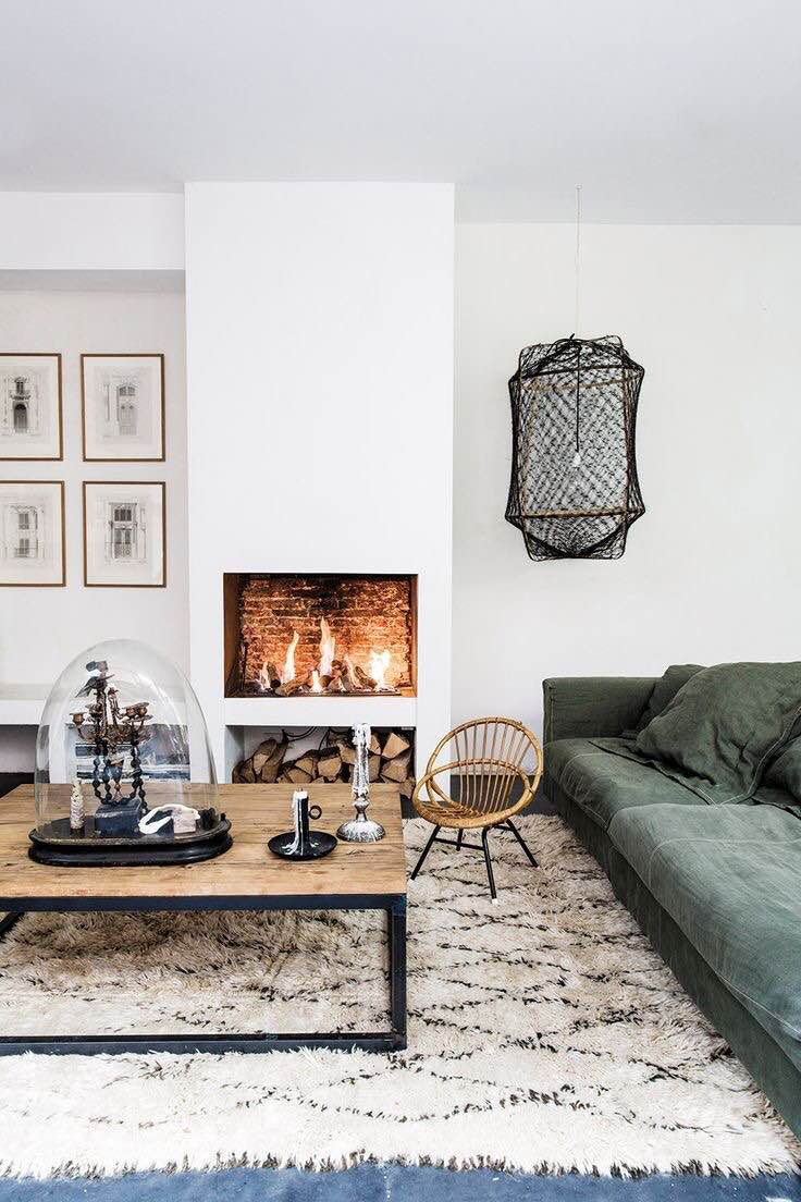 This muted green velvet sofa and boho rug and pendant light are everything!